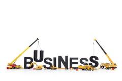 Acumule um negócio: Máquinas que constroem o negócio-wo Imagens de Stock Royalty Free