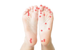 Acupressure of female feet Stock Photography