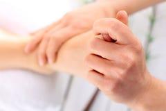 Acupressure, foot massage Stock Images