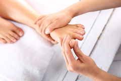 Acupressure, foot massage Royalty Free Stock Photos