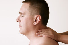Acupressure - Neck. Acupressure therapy. Massage where the pressure is applied to the man's neck. I will be very happy if you let me know when you use this image Royalty Free Stock Images