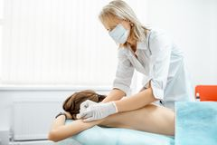 Acupuncture medical treatment with Neuropathologist stock photo
