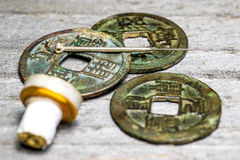 Acupuncture needle on chinese coins Stock Image