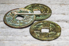 Acupuncture needle on chinese coins Stock Photo