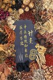 Acupuncture Needles with Chinese Herbs. Chinese acupuncture needles, feng shui coins with traditional herbs and calligraphy script Translation reads as royalty free stock photography