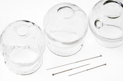 Acupuncture needles and cupping glasses Royalty Free Stock Photo