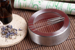 Acupuncture needles, moxa sticks and lavender Royalty Free Stock Photo