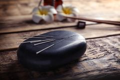 Acupuncture needles with stone