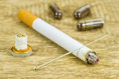 Acupuncture to stop smoking Royalty Free Stock Photography