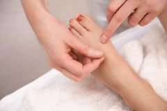 Acupuncture treatment on foot Royalty Free Stock Photography