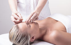 Acupuncture. Young girl getting, acupuncture treatment on bench Stock Photo