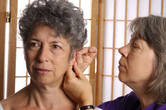 Acupunture On Ear of Woman Royalty Free Stock Image