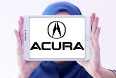 Acura car logo. Logo of acura car brand on samsung tablet holded by arab muslim woman stock photos