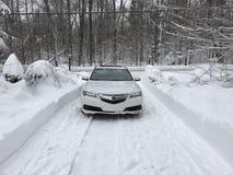 Acura TLX AWD in de sneeuw in de winter met lichten  royalty-vrije stock afbeelding