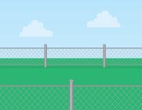 Łańcuszkowego połączenia ogrodzenia trawa Fotografia Royalty Free