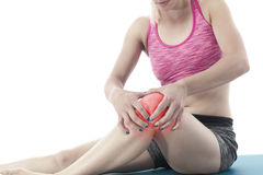 Acute pain in a knee. Woman holding hand to spot of knee-aches Stock Photo