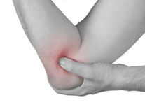 Acute pain in a man elbow. Royalty Free Stock Photography