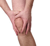 Acute pain in a man knee Stock Photo