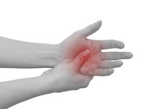 Acute pain in a man palm. Female holding hand to spot of palm-ac Royalty Free Stock Images