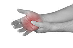Acute pain in a man palm. Stock Image