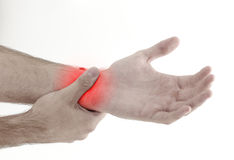 Acute pain in a man palm. Male holding hand to spot of palm-ache Stock Image