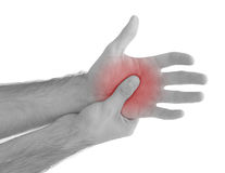 Acute pain in a man palm. Male holding hand to spot of palm-ache Stock Photography