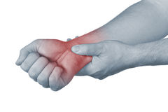 Acute pain in a man wrist. Male holding hand to spot of wrist pain Royalty Free Stock Photo