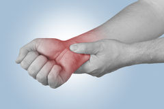Acute pain in a man wrist. Stock Photos