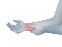 Acute pain in a man wrist. Male holding hand to spot of wrist pa Royalty Free Stock Photos