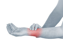 Acute pain in a man wrist. Male holding hand to spot of wrist pa Royalty Free Stock Image