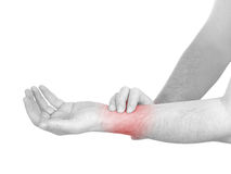 Acute pain in a man wrist. Male holding hand to spot of wrist pa Stock Images