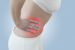 Acute pain in a woman abdomen Stock Image
