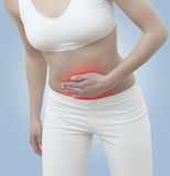 Acute pain in a woman abdomen Royalty Free Stock Image