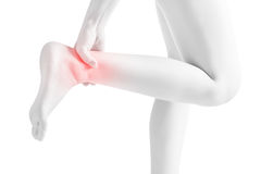 Acute pain in a woman  ankle isolated on white background. Clipping path on white background. Acute pain in a woman  ankle isolated on white background Stock Photography