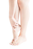 Acute pain in a woman  ankle isolated on white background. Clipping path on white background. Acute pain in a woman  ankle isolated on white background Royalty Free Stock Image