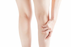 Acute pain in a woman  calf leg isolated on white background. Clipping path on white background. Acute pain in a woman  calf leg isolated on white background Stock Photo