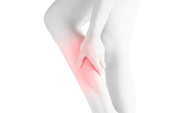 Acute pain in a woman  calf leg isolated on white background. Clipping path on white background. Royalty Free Stock Images
