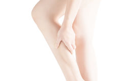 Acute pain in a woman  calf leg isolated on white background. Clipping path on white background. Royalty Free Stock Photography