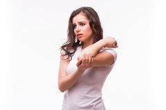 Acute pain in a woman elbow. Female is holding hand to spot of elbow pain indicating location of the pain. Royalty Free Stock Photography