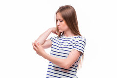 Acute pain in a woman elbow. Stock Images