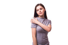 Acute pain in a woman elbow. Female is holding hand to spot of elbow pain indicating location of the pain. Isolation on a white background Stock Photography