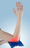 Acute pain in a woman elbow. Royalty Free Stock Photos