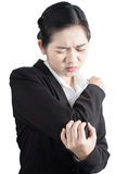 Acute pain in a woman elbow isolated on white background. Clipping path on white background. Stock Image