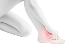 Acute pain in a woman feet isolated on white background. Clipping path on white background. Stock Photography