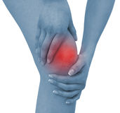 Acute pain in a woman knee. Concept photo with blue skin with read spot indicating pain. Isolation on a white background Royalty Free Stock Photography