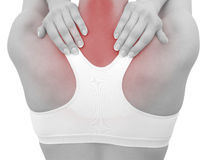 Acute pain in a woman neck. Female holding hand to spot of neck-aches Royalty Free Stock Images