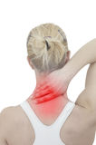 Acute pain in a woman neck. Female holding hand to spot of neck- Royalty Free Stock Image