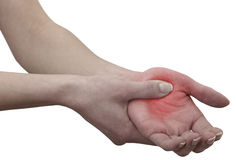 Acute pain in a woman palm. Female holding hand to spot of palm-ache Royalty Free Stock Photography
