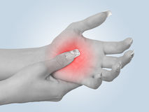 Acute pain in a woman palm Stock Photos
