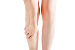 Acute pain in a woman shin isolated on white background. Clipping path on white background. Acute pain in a woman shin isolated on white background. Clipping Royalty Free Stock Image